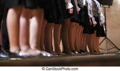 legs in pantyhose of girl - children choir - rehearsal of...