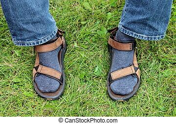 Legs in sandals