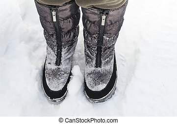 Legs In Snow Boots