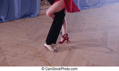 Legs of a pair of dancing latin dance - Legs stepping into...