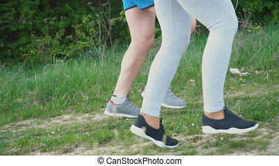 Legs of a traveling couple of people