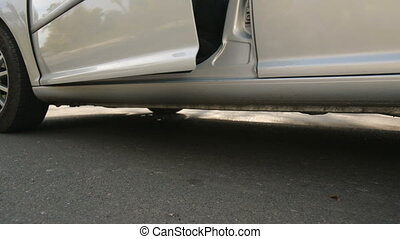 Legs of a woman coming out of the car - Woman in beautiful...