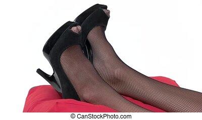 Legs of a woman lying. Dark colored heel shoes. Sleep all...