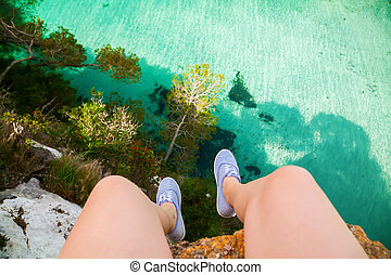 legs of a woman sitting on the edge