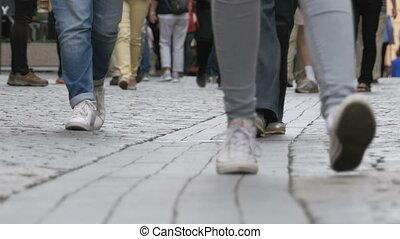 Legs of Crowd People Walking on the Street