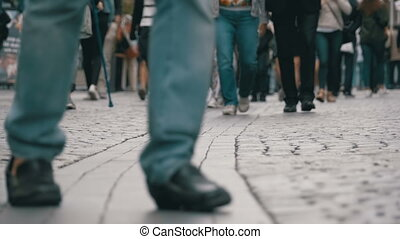 Legs of Crowd People Walking on the Street in Slow Motion