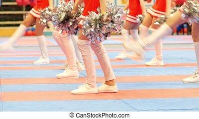 Legs of dancing cheerleaders at the karate tornament, close...