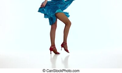 Legs of girl dancing elements of samba in slow motion