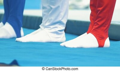 Legs of male particapants of gymnastic championship, close...