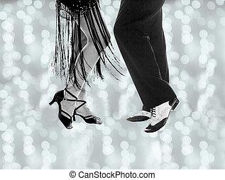 Legs of man and woman dancing