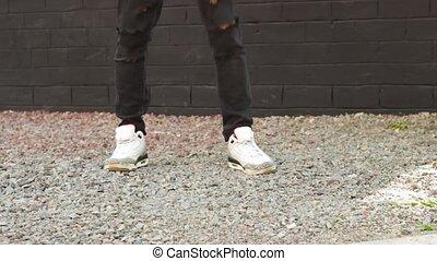 Legs of man dancing - Legs of man who dancing outdoor in...