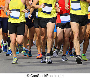 legs of many runners during a race
