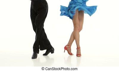 Legs of pair professional ballroom dancers perform rumba,...