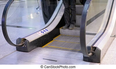 Legs of People Moving on an Escalator Lift in Shopping Center