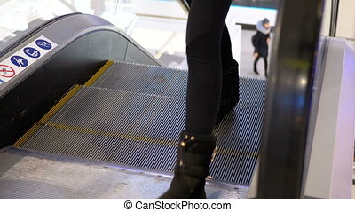Legs of People Moving on an Escalator Lift in Shopping...