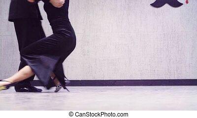 Legs of professional dancers dancing tango