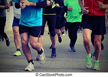 legs of runners during a race with old toned effect