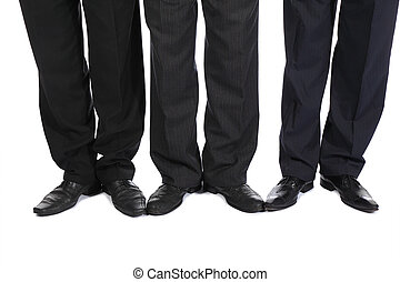 Legs of three businessmen