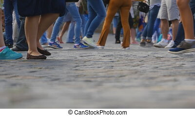 Legs of tourists on Red Square in Moscow