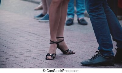 Legs of two professional dancers doing a Latino dance and...