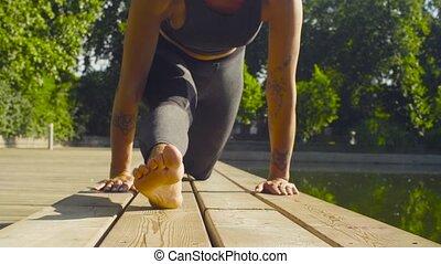 Legs of woman doing yoga asana - hanumanasana - Close up of...