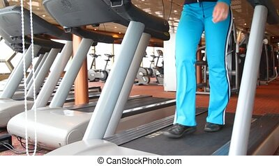 legs of woman exercising in gym