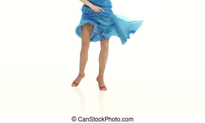 Legs of woman in ballroom dances. White background, close ups