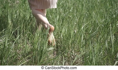 Legs of woman in grass