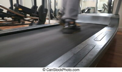 Legs Of  Woman Walking And Running On Treadmill