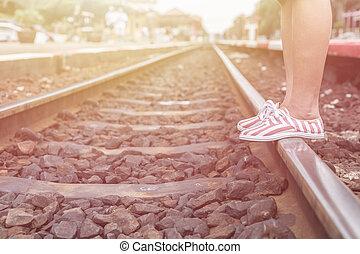 Legs of woman walking in railway
