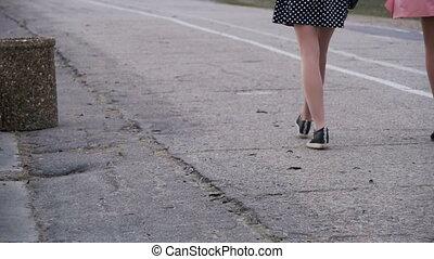 Legs of Woman Walking in the Park. Slow Motion
