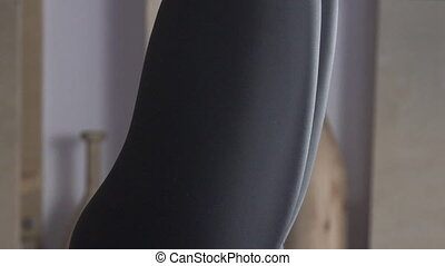 Legs of woman who is doing handstand in yoga class, close up.
