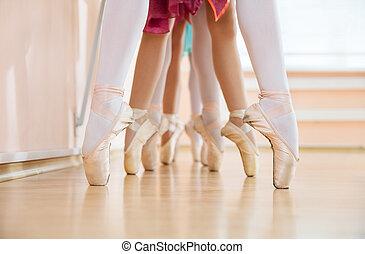 Legs of young ballerinas