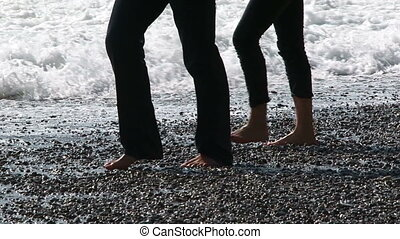 Legs of young people - Two young men walking along the...