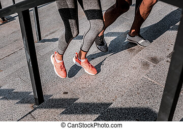 Legs of young professional runners during the workout