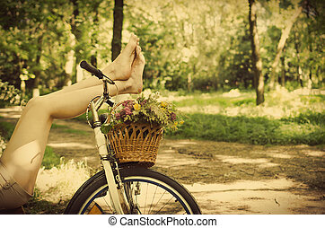 Legs on a bicycle - Legs of a beautiful woman on a bicycle