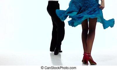 Legs pair ballroom dancers perform salsa, white background....