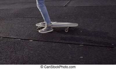 legs riding the longboard - Man's legs riding the long...