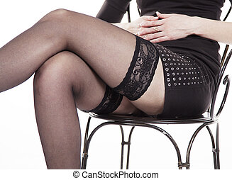 legs seated woman in black stockings closeup