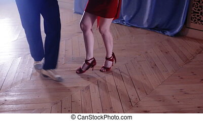 Legs stepping into tango dance - Legs of a pair of dancing...