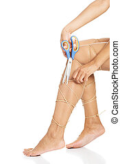 Legs tied with rope - Legs pain concept - legs tied with...