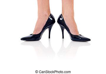 Legs with black high heels