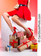 legs with gift boxes