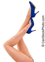 Legs with high heels isolated against a white background