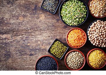 Legumes - Bowls of various legumes (chickpeas, green peas,...