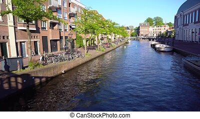 Leiden canals in Netherlands - canal water in old town with...