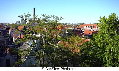 Leiden canals in Netherlands - roofs in old town with...