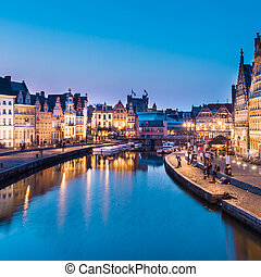 """Picturesque medieval buildings overlooking the """"Graslei harbor"""" on Leie river in Ghent town, Belgium, Europe."""