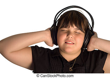 Leisure Activity - A young girl listening to some music on a...