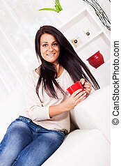 Leisure Activity - Beautiful young woman resting with coffee...